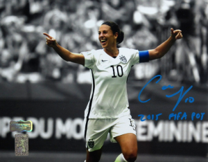 "Carli Lloyd Signed US Women's Soccer 8x10 Celebrating Spotlight Photo with ""2015 FIFA POY"" Inscription-0"