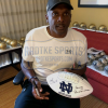 """Tim Brown Signed Notre Dame Fighting Irish Embroidered NCAA Logo Football with """"Heisman 87 - Play Like A Champion"""" Inscription-4148"""